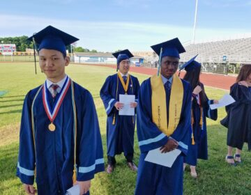 North Penn High School valedictorian Tony Xu (left) joins other graduation speakers at the high school stadium in Lansdale, where they delivered their speeches for a video recording. (Peter Crimmins/WHYY)