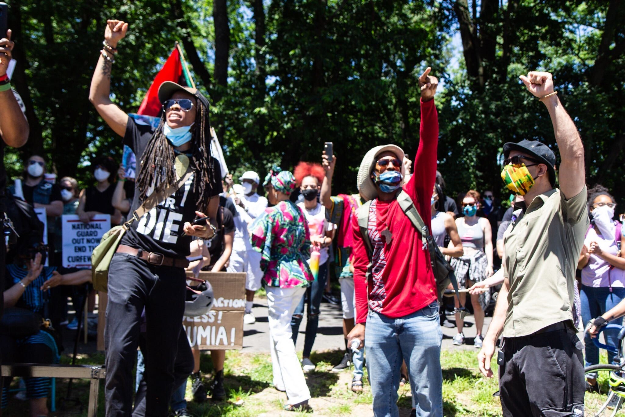 Mike Africa Jr. raises a fist with other protesters