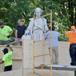 Workers box up the statue of Christopher Columbus
