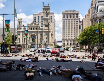 Protesters lay in the intersection of 15th and JFK