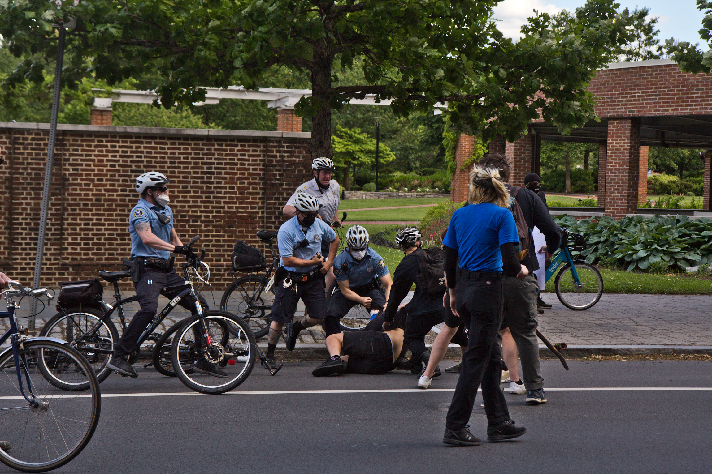 Police arrest a protester in front of Independence Mall