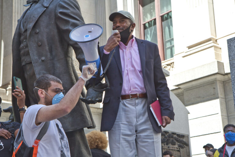 Philadelphia NAACP President Rodney Muhammad speaks at a peaceful protest at City Hall. (Kimberly Paynter/WHYY)