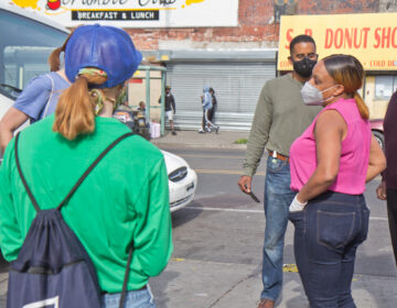 3rd District Councilperson Jamie Gauther talks to clean-up volunteers in West Philadelphia. (Kimberly Paynter/WHYY)