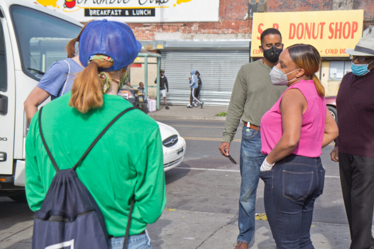 3rd District CouncilmemberJamie Gauther talks to clean-up volunteers in West Philadelphia. (Kimberly Paynter/WHYY)