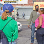 3rd District Councilmember Jamie Gauther talks to cleanup volunteers in West Philadelphia. (Kimberly Paynter/WHYY)