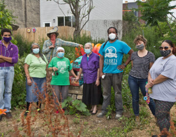 Gardeners (from left) Josh Reaves, Mirta Gonzalez, Sara Vega, Willow Zef, Morgana Ginet, Anthony Batrick, Lauren Troop and Ada Marie Biaz at the César Andreu Iglesias Community Garden in Kensington. (Kimberly Paynter/WHYY)