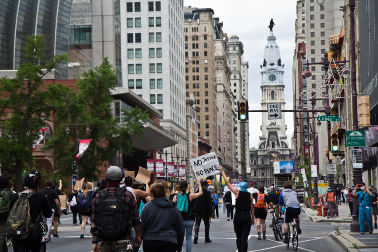 """Protesters marched through Center City Philadelphia in June chanting """"George Floyd"""" and """"Breonna Taylor,"""" while advocating for their justice. (Kimberly Paynter/WHYY)"""