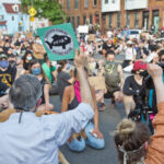 Fishtown residents raised fists in solidarity with country-wide protests against the death of George Floyd at the hands of police. (Kimberly Paynter/WHYY)