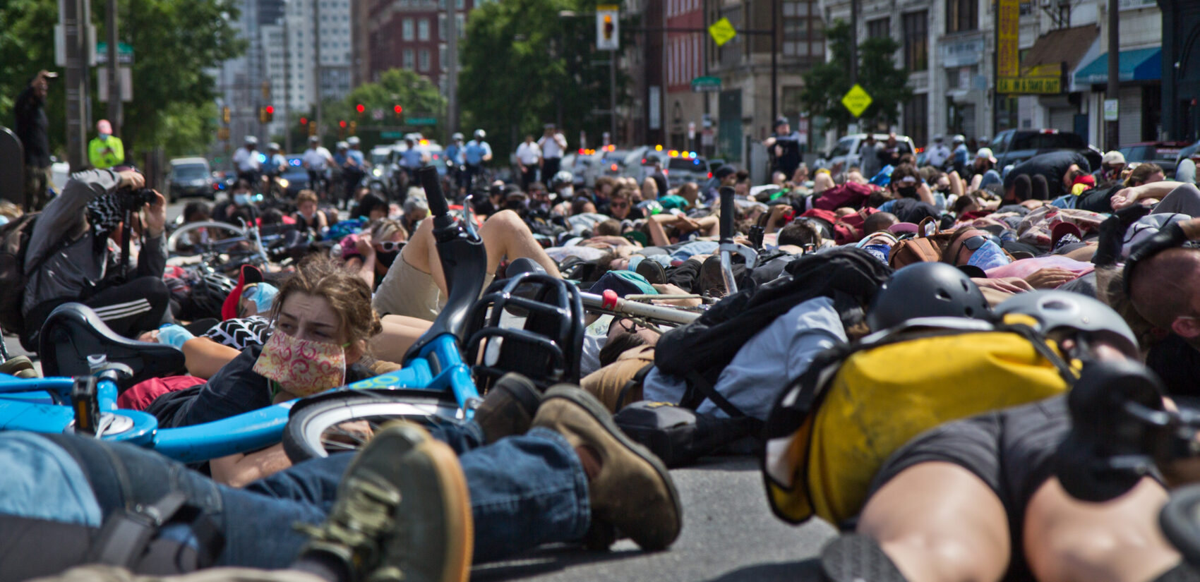 Protesters lie down on the North section of Broad Street