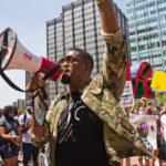 "Nicholas ""Sixx"" King, an activist and filmmaker, led a peaceful protest through Center City, Philadelphia Thursday afternoon. (Kimberly Paynter/WHYY)"