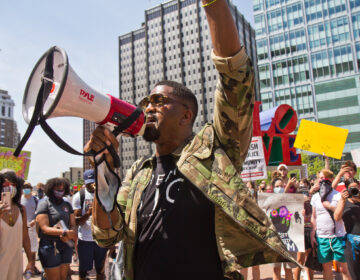"Nicholas ""Sixx"" King, an activist and filmmaker, led a peaceful protest through Center City, Philadelphia Thursday afternoon. (Kimberly Paynter/WHYY)"