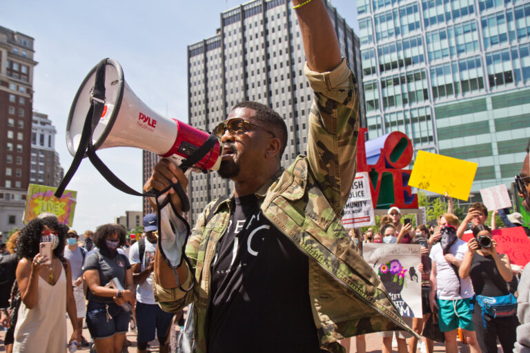 Sixx King, an activist and filmmaker, led a peaceful protest through Center City, Philadelphia Thursday afternoon. (Kimberly Paynter/WHYY)