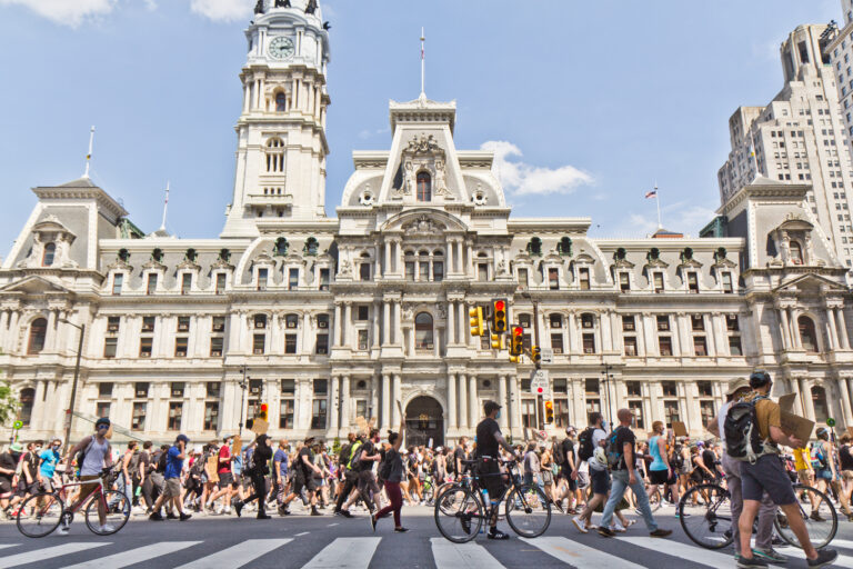 Protesters marched by Philadelphia's City Hall Thursday in ongoing efforts to get officials to address police brutality against Black people. (Kimberly Paynter/WHYY)
