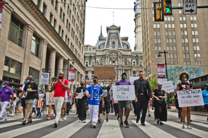 Members of the Omega Psi Phi Fraternity organized a March from the Octavius Catto statute at City Hall to the African American History Museum in Philadelphia calling for equality and justice. (Kimberly Paynter/WHYY)