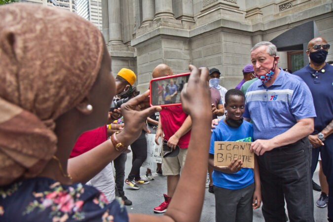 Philadelphia Mayor Jim Kenney posed for a picture with Ibra, 8, Saturday, as Black fraternities and sororities gathered at City Hall to call for social reform in Philadelphia. (Kimberly Paynter/WHYY)