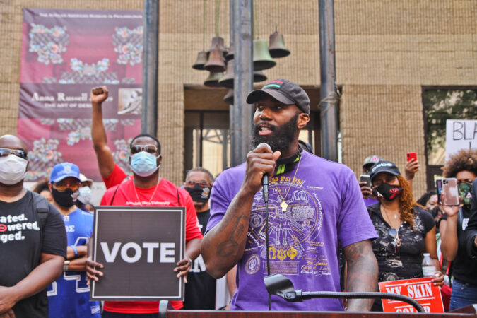 Former Philadelphia Eagles Safety Malcolm Jenkins called for reform outside the African American Museum of Philadelphia. (Kimberly Paynter/WHYY)