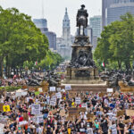 Protesters took over the Benjamin Franklin Parkway Saturday to hear speakers from the Philly Socialists, who along with demanding an end to police brutality and justice for George Floyd, called for fair housing, libraries, and healthcare for all. (Kimberly Paynter/WHYY)