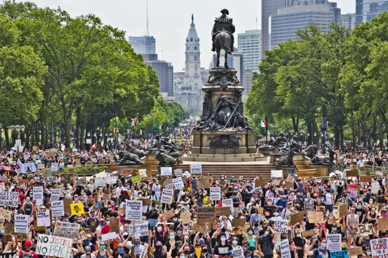 Protesters took over the Benjamin Franklin Parkway Saturday to hear speakers from the Party for Socialism and Liberation - Philly, who along with demanding an end to police brutality and justice for George Floyd, called for fair housing, libraries, and healthcare for all. (Kimberly Paynter/WHYY)