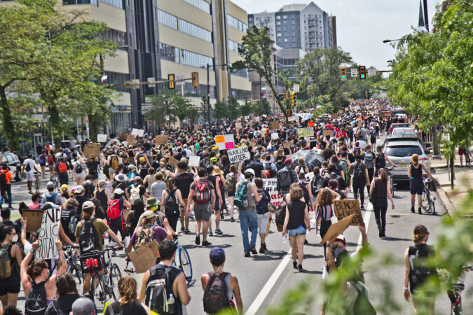 Thousands of protesters marched through Philadelphia as the week-long demonstrations continued Saturday. (Kimberly Paynter/WHYY)