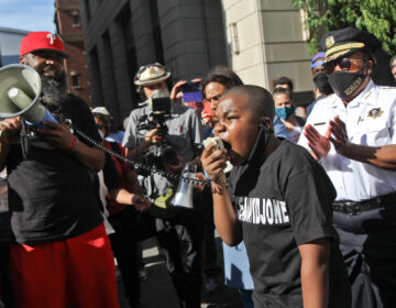 Isaac Gardner, 11, joined chief defender Keir Bradford-Grey and Philadelphia County SheriffRochelleBilalin protest of the Black lives lost to police brutality. (Kimberly Paynter/WHYY)