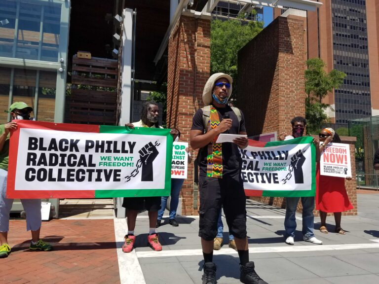 Mike Africa, Jr., reading list of demands as part of the Black Philly Radical Collective. (Peter Crimmins / WHYY)