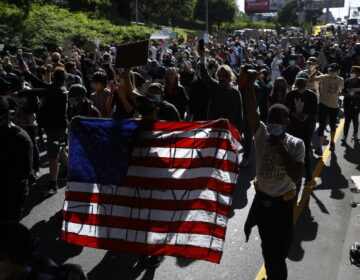 Protesters march down Interstate 676 in Philadelphia, Monday, June 1, 2020 in the aftermath of protest and unrest in reaction to the death of George Floyd. (AP Photo/Matt Rourke)
