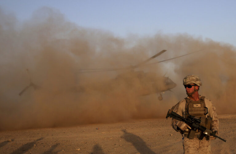 In this Aug. 27, 2017 file photo, a U.S. Marine takes part during a training session for Afghan army commandos in Shorab military camp in Helmand province, Afghanistan. (AP Photo/Massoud Hossaini, File)