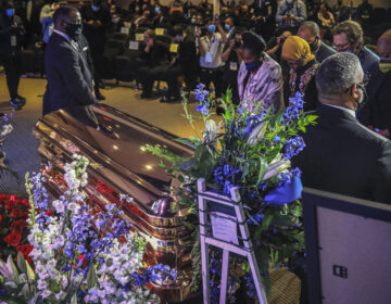 Members of the Congressional Black Caucus, at right, including Rep. Sheila Jackson-Lee, left, wearing blue face mask, U.S. Rep. Ilhan Omar, second from left, and U.S. Rep. Ayanna Pressley, right, stand at the casket of George Floyd before a memorial service at North Central University, Thursday, June 4, 2020, in Minneapolis. (Bebeto Matthews/AP Photo)