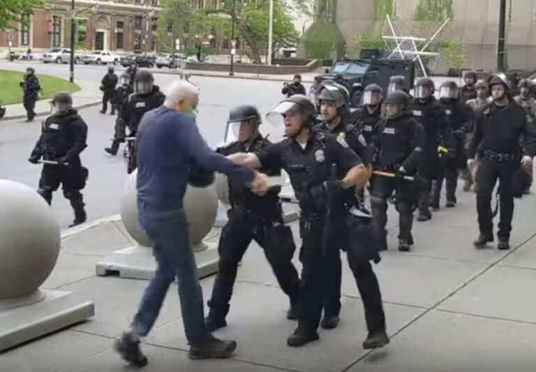 In this image from video provided by WBFO, a Buffalo police officer appears to shove a man who walked up to police Thursday, June 4, 2020, in Buffalo, N.Y. (Mike Desmond/WBFO via AP)