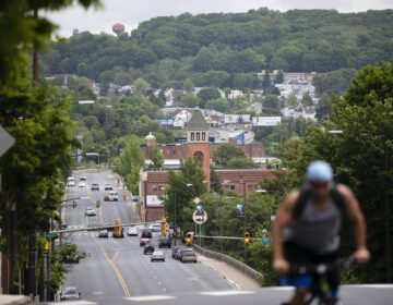 A cyclist peddles up a hill in Allentown, Pa., on Friday, May 29, 2020. (AP Photo/Matt Rourke)