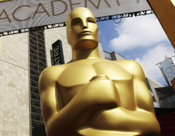 In this Feb. 21, 2015 file photo, an Oscar statue appears outside the Dolby Theatre for the 87th Academy Awards in Los Angeles. (Photo by Matt Sayles/Invision/AP, File)
