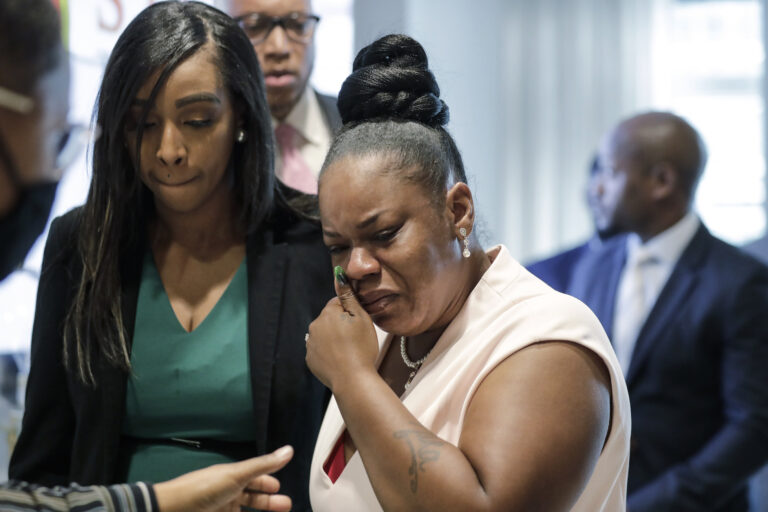 Tomika Miller, center, widow of Rayshard Brooks cries as she leaves a news conference, Wednesday, June 17, 2020 in Atlanta. Fulton County District Attorney Paul L. Howard Jr. announced former Atlanta Police Officer Garrett Rolfe faces charges including felony murder in the fatal shooting of Rayshard Brooks on June 12. (AP Photo/Byrnn Anderson)