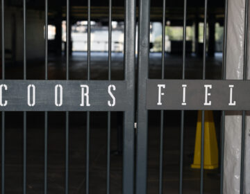 The main gate of Coors Field, home of the Major League Baseball team the Colorado Rockies, is locked early Tuesday, June 23, 2020, in Denver. (AP Photo/David Zalubowski)