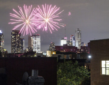 Fireworks explode during Juneteenth celebrations above the Bedford-Stuyvesant neighborhood in the Brooklyn borough of New York, Friday, June 19, 2020. (AP Photo/John Minchillo)