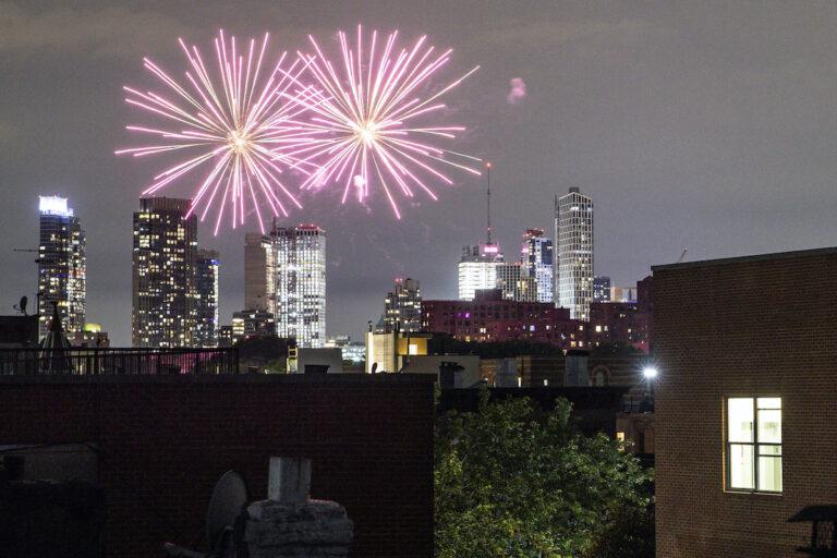 Fireworks explode during Juneteenth celebrations above the Bedford-Stuyvesant neighborhood in the Brooklyn borough of New York, Friday, June 19, 2020. (AP Photo/John Minchillo)