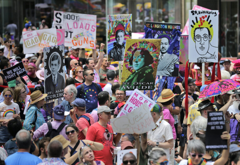 In this June 30, 2019, file photo, marchers carry signs with historical LGBTQ figures during the Queer Liberation March in New York. (AP Photo/Seth Wenig, File)