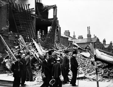 Britain's Prime Minister Winston Churchill, right, accompanied by officials, inspects the damage caused by German bombs in London's East End, Sept. 9, 1940, during the Blitz.  (AP Photo/British Official Photo)