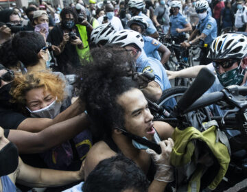 Police and protesters clash in Philadelphia