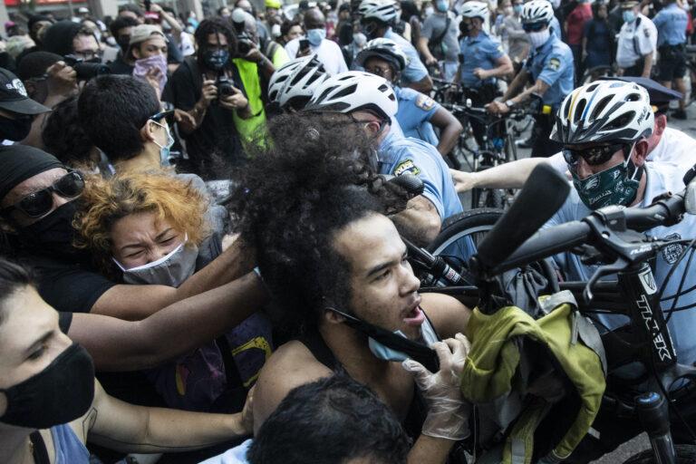 Police and protesters clash in Philadelphia