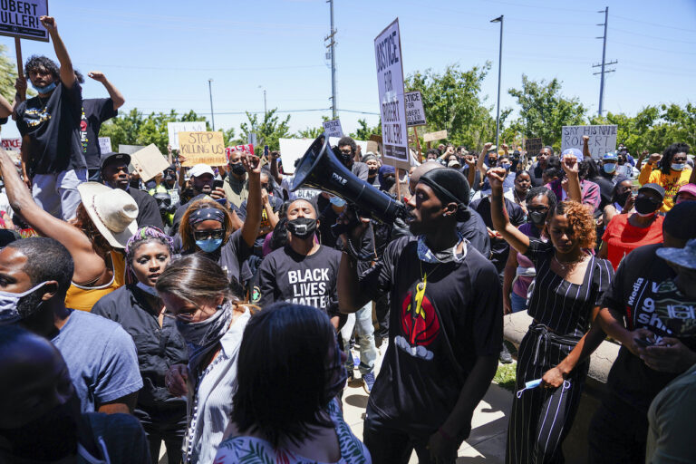 Protesters march, Saturday, June 13, 2020, in Palmdale, Calif.