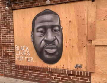 George Floyd mural painted on South Street in Philadelphia. (Elisabeth Perez-Luna/WHYY)