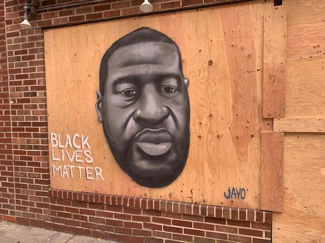 George Floyd mural painted on South Street in Philadelphia. (Elisabeth Perez-Luna/WHYY)