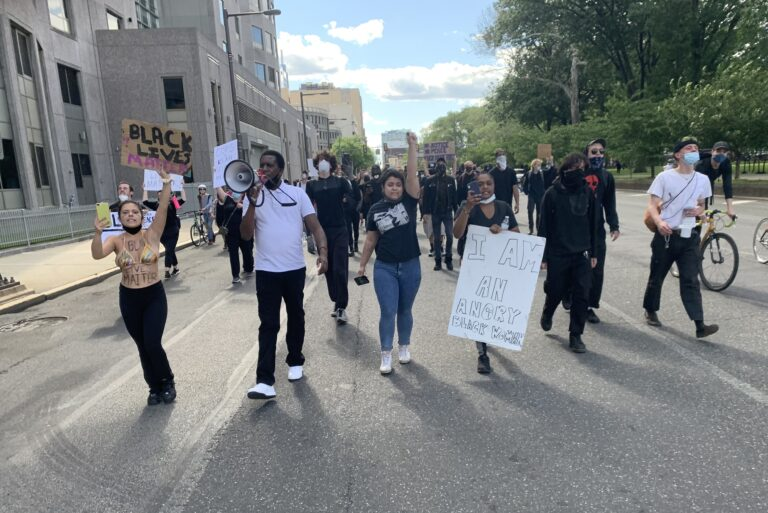 Protesters march past Philadelphia Police Department headquarters on Sunday, May 31, 2020. (Chris Norris/WHYY)