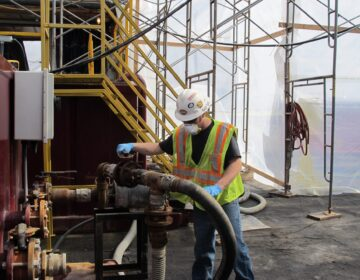 A worker operates valves at a frack water recycling plant used by Cabot Oil and Gas. (StateImpact Pennsylvania)