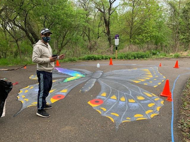 Jay Coreano's street murals in progress at Tacony Creek Park. (Courtesy of Julie Slavet/TTF Watershed Partnership)