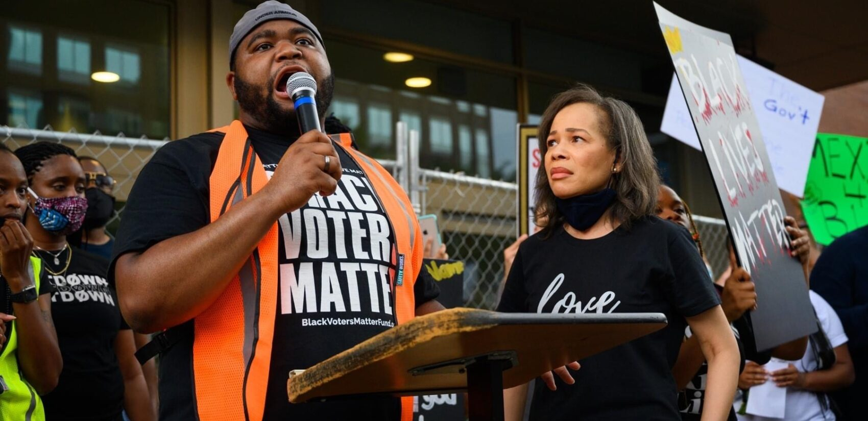 Organizer Coby Owens, joined by U.S. Rep. Lisa Blunt Rochester at a Wilmington protest in June, says the use of deadly force law needs to be amended or scrapped. (Courtesy of Coby Owens)