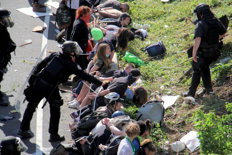 Police arrest dozens of protesters on Route 676 near 21st Street after they blocked traffic.