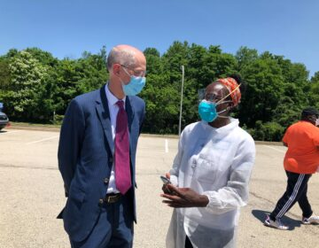 Philadelphia Health Commissioner Thomas Farley speaks with Dr. Ala Stanford, head of the Black Doctors COVID-19 Consortium. (Nina Feldman/WHYY)
