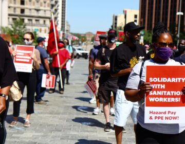 Labor union members including teachers and librarians joined a solidarity protest for the conditions of sanitation workers in the city of Philadelphia.(Kimberly Paynter/WHYY)
