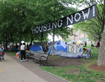A growing homeless encampment at 22nd Street and the Ben Franklin Parkway is actually a protest against a law that prohibits camping on public property. (Emma Lee/WHYY)